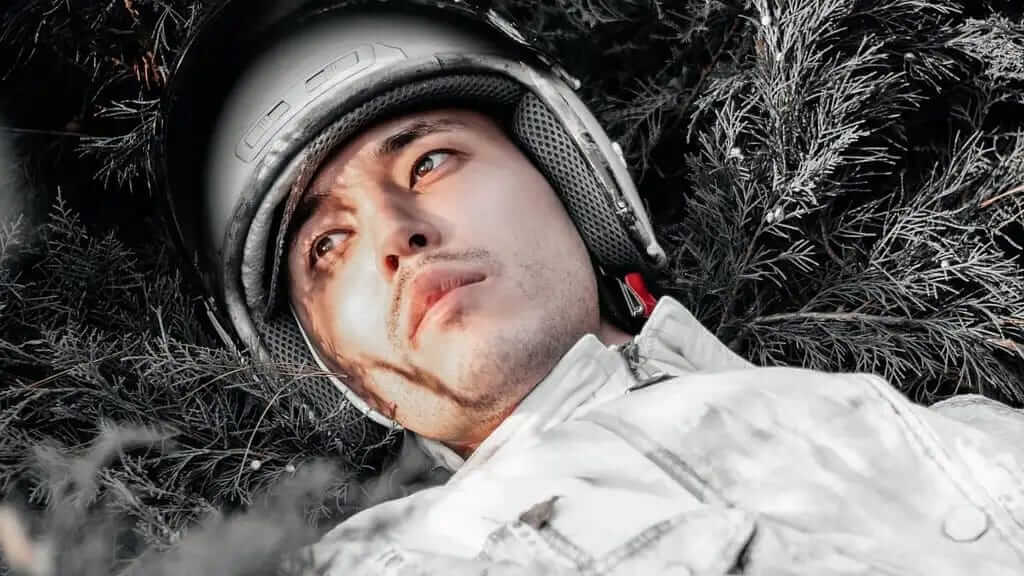 Astronaut exhausted in field. Dare to go further.