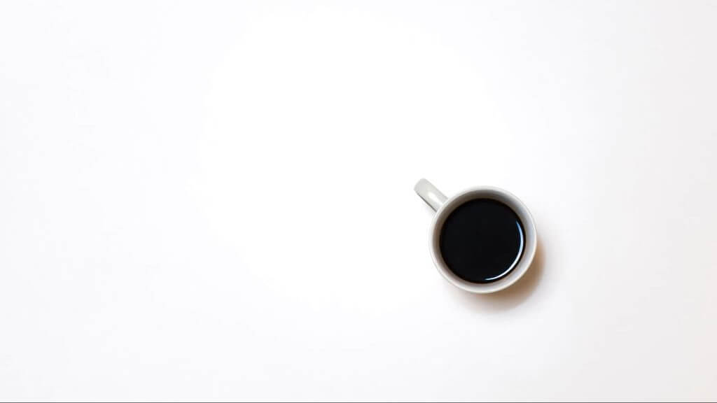 Coffee cup on white background. Complexity understood through simplicity